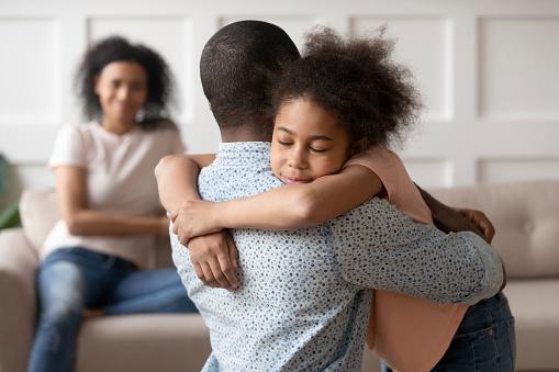 Dad hugging daughter
